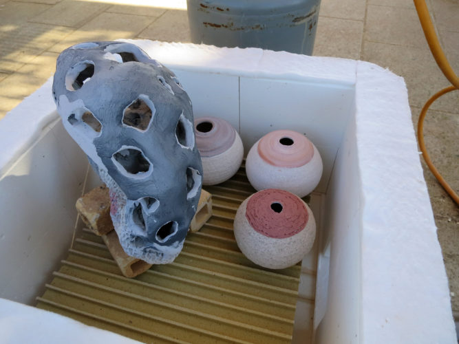 Inloading the Kiln - 1st International Ceramic Symposium in Salento and Raku Workshop