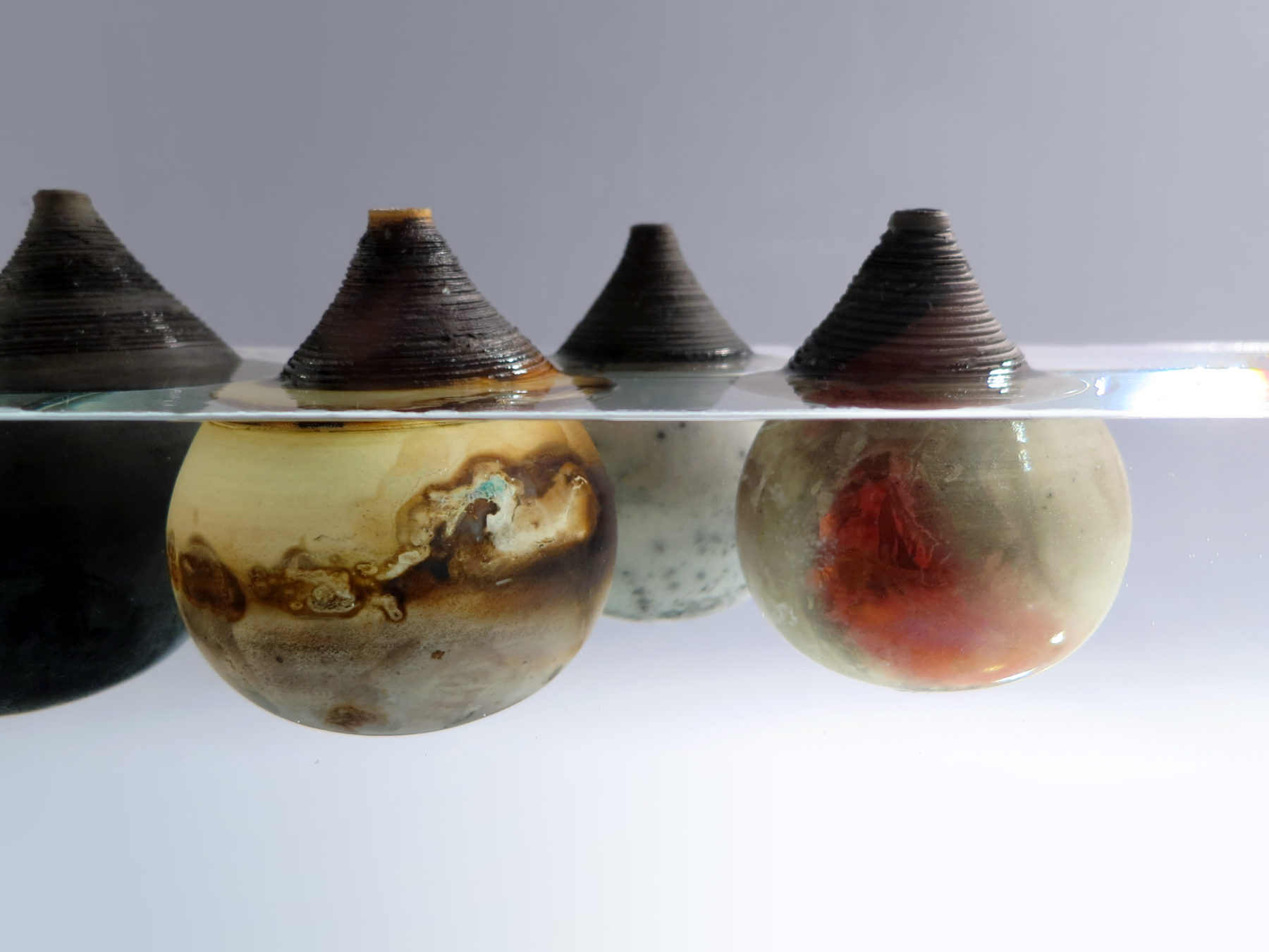 Under the Surface: Whispering Globes - Ildikó Károlyi