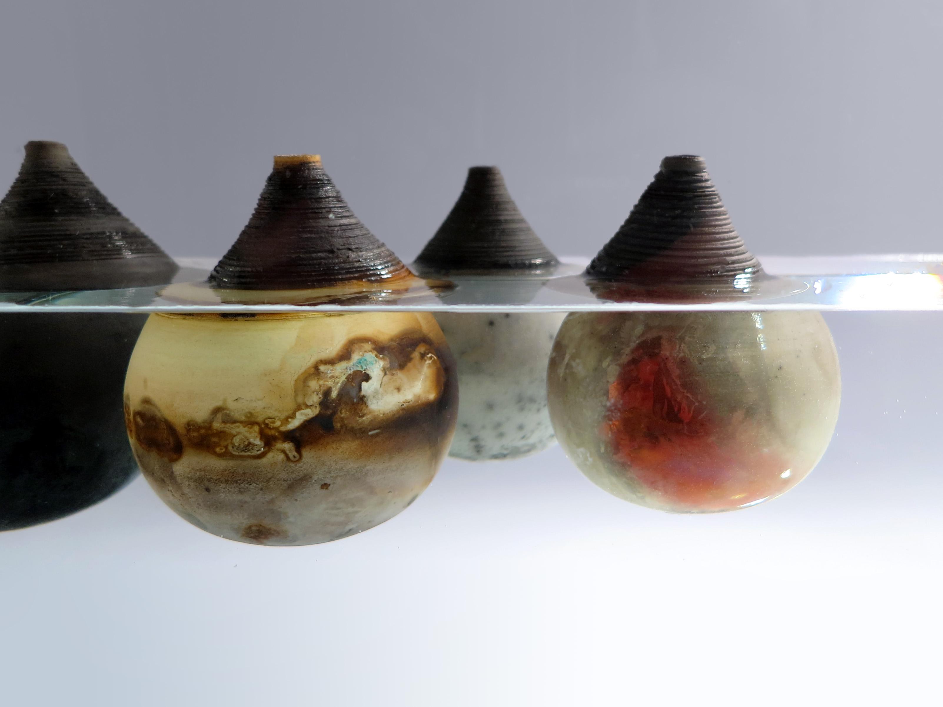 Under the Surface: Whispering Globes - Ildikó Károlyi