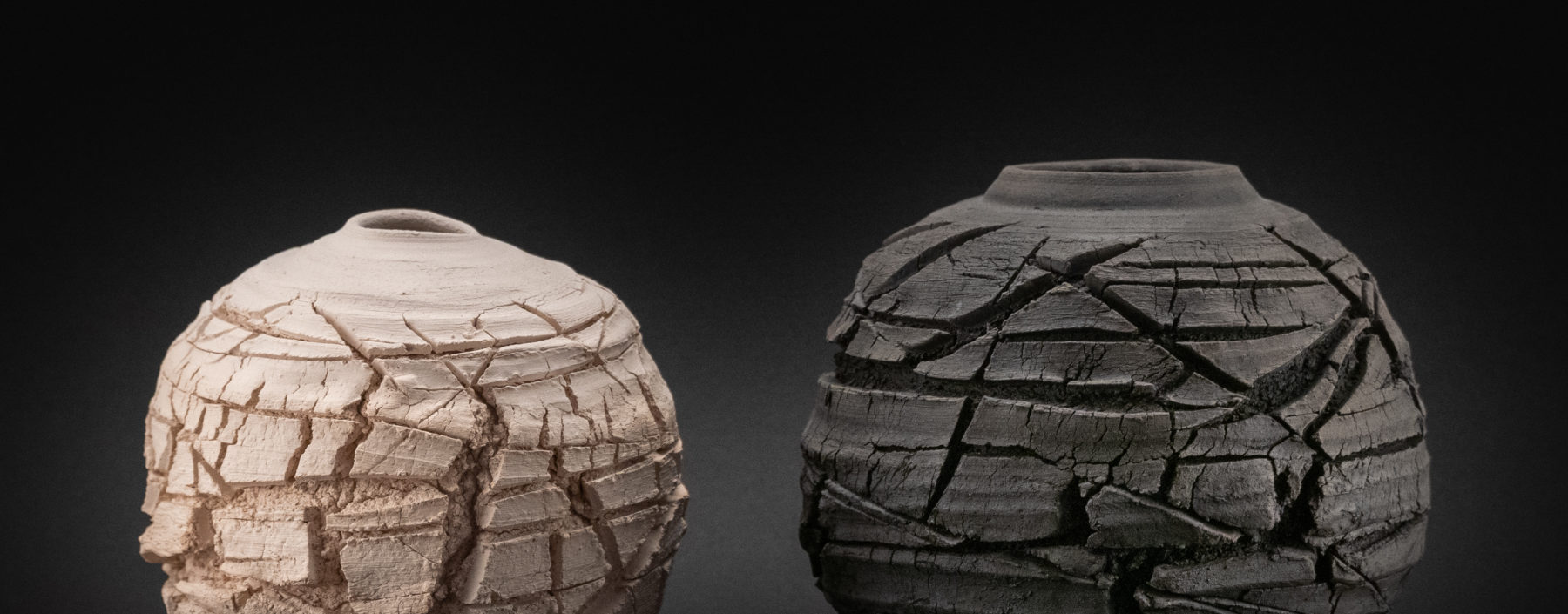 Eris and Charon: Raku-fired Whispering Globes by Ildikó Károlyi