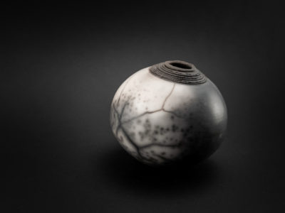 Dirty Snowball: Naked Raku Whispering Globe - Ildikó Károlyi