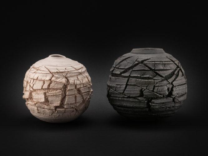 Eris and Charon: Raku Whispering Gobes by Ildikó Károlyi