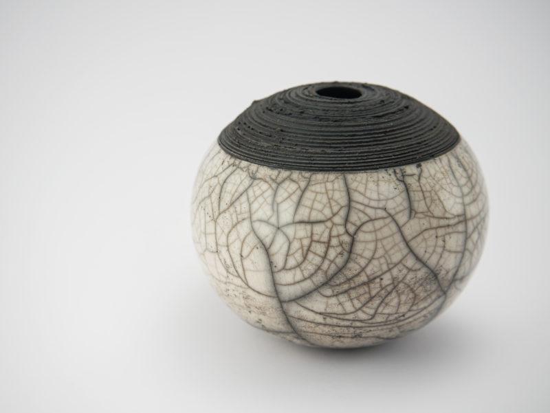 Junction: Raku Whispering Globe by Ildikó Károlyi