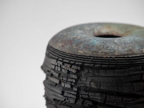 Pitch Black: Raku Ceramic Whispering Globe by Ildikó Károlyi