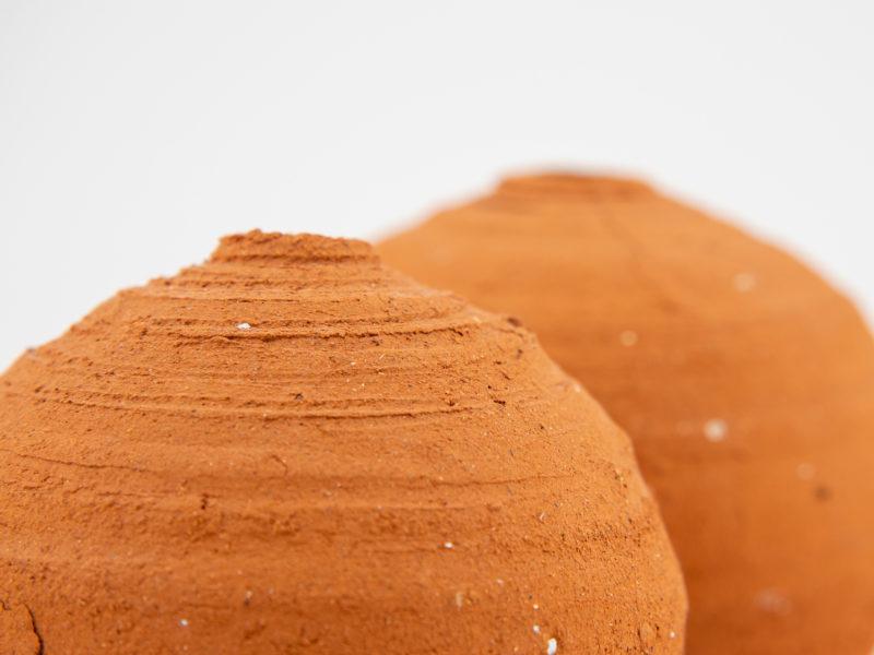 Wild-clay Whispering Globe couple close up by Ildikó Károlyi ceramics